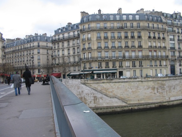 Just over the bridge there is a little brasserie … Can you see the awnings?